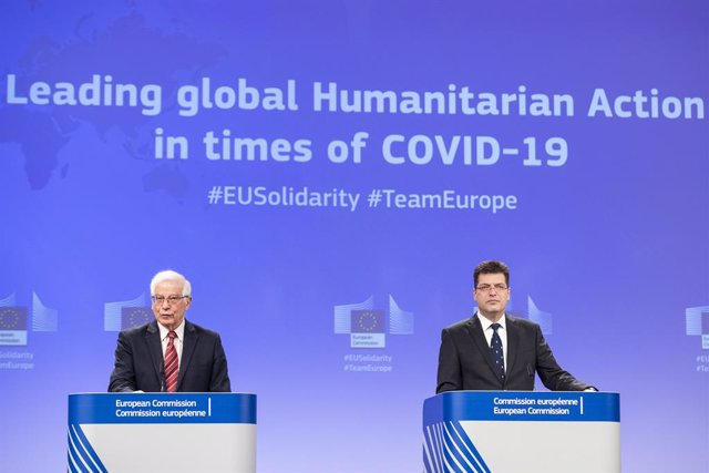 HANDOUT - 10 March 2021, Belgium, Brussels: European Union foreign policy chief Josep Borrell (L) and European Commissioner for Crisis Management Janez Lenarcic attend a press conference at the EU headquarters on the new outlook for the EU's humanitarian