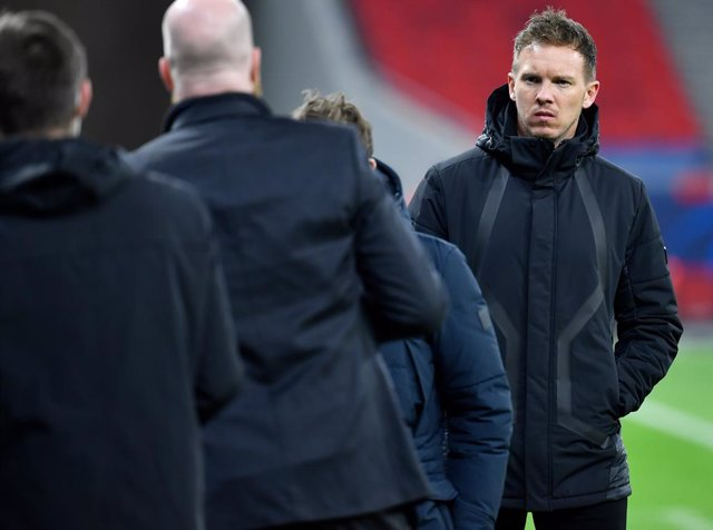 10 March 2021, Hungary, Budapest: Leipzig coach Julian Nagelsmann (R) is pictured after the UEFA Champions League round of 16, second leg soccer match between RB Leipzig and Liverpool FC at Puskas Arena. Photo: Marton Monus/dpa