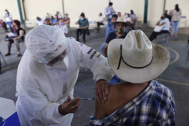 10 March 2021, Mexico, Uruapan: An elderly receives a dose of Pfizer/BioNTech COVID-19 vaccine during mass vaccine inside of Hermanos Lopez Rayon sports center. Photo: Carlos Guzman/eyepix via ZUMA Wire/dpa