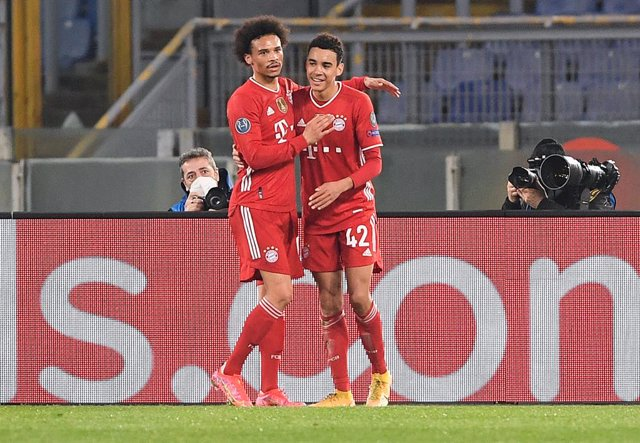 23 February 2021, Italy, Rome: Munich's Jamal Musiala (R) celebrates with team mate Leroy Sane after scoring their side's second goal during the UEFA Champions League round of 16 first leg soccer match between SS Lazio and FC Bayern Munich at the Olympic