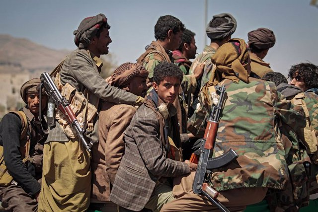09 March 2021, Yemen, Sanaa: Armed members of the Houthi rebel movement ride a vehicle during a funeral procession held for Houthi fighters who were allegedly killed in recent fighting with the Yemeni Saudi-backed government forces. Photo: Hani Al-Ansi/dp