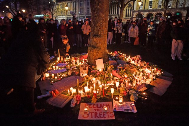"""13 March 2021, United Kingdom, Bristol: People gather on College Green in Bristol after the """"Reclaim These Streets"""" vigil this evening was officially cancelled. Serving police constable Wayne Couzens, 48, was charged on Friday evening with kidnapping and"""