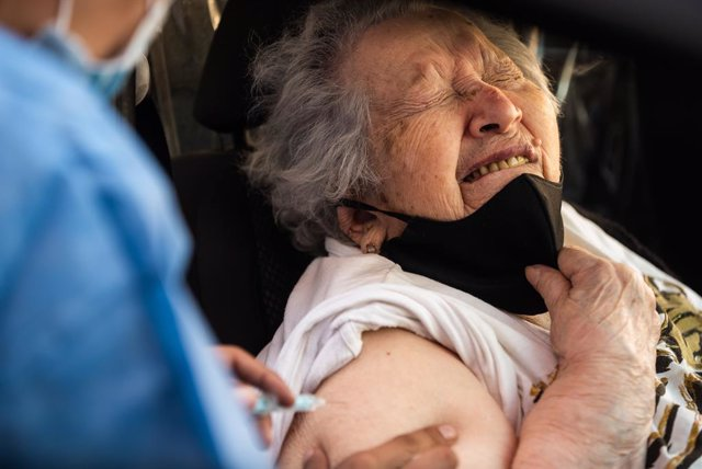 09 March 2021, Argentina, Buenos Aires: An elderly women reacts while receiving  her dose of a coronavirus vaccine inside her car. Photo: Alejo Manuel Avila/Le Pictorium Agency via ZUMA/dpa