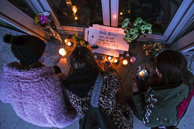 """13 March 2021, United Kingdom, Bournemouth: Three women light candles in Bournemouth after the """"Reclaim These Streets"""" vigil this evening was officially cancelled. Serving police constable Wayne Couzens, 48, was charged on Friday evening with kidnapping a"""