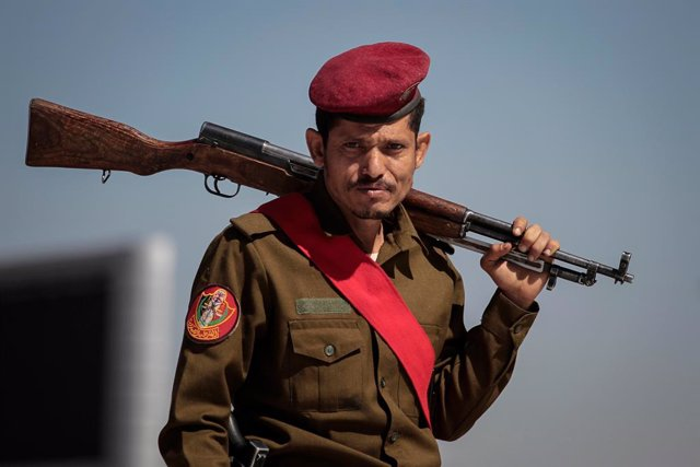 09 March 2021, Yemen, Sanaa: A military policeman attends a funeral procession held for members of the Houthi rebel movement who were allegedly killed in recent fighting with the Yemeni Saudi-backed government forces. Photo: Hani Al-Ansi/dpa