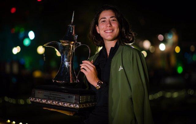 Garbine Muguruza of Spain poses with the trophy after winning the 2021 Dubai Duty Free Tennis Championships WTA 1000 tournament