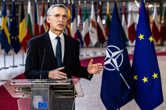 HANDOUT - 26 February 2021, Belgium, Brussels: The North Atlantic Treaty Organization (NATO) Secretary General Jens Stoltenberg speaks during a joint press conference with the European Council President Charles Michel (R) ahead of a video conference with