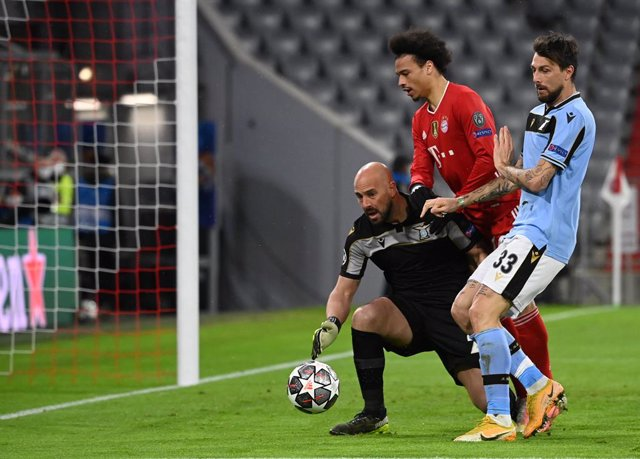 17 March 2021, Bavaria, Munich: Munich's Leroy Sane in action against Lazio goalkeeper Pepe Reina and Francesco Acerbi during the UEFAChampions League round of 16, second leg soccer match between Bayern Munich and SSLazio at Allianz Arena. Photo: Sven H