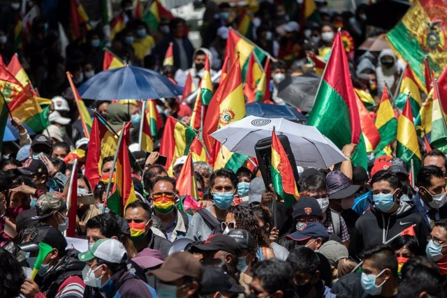 17 March 2021, Bolivia, La Paz: People wave flags of Bolivia during a protest against the arrest of Bolivia's former interim president Jeanine Anez and other ex-ministers. A group of doctors took part in the rally, calling for the repeal of a new law whic