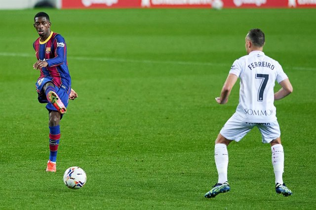 15 March 2021, Spain, Barcelona: Barcelona's Ousmane Dembele and Huesca's David Ferreiro in action during the Spanish Primera Division soccer match between FC Barcelona and SD Huesca at Camp Nou stadium. Photo: Gerard Franco/DAX via ZUMA Wire/dpa