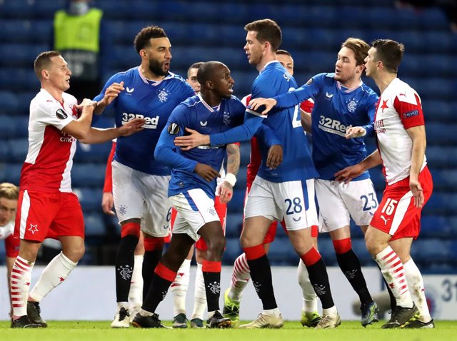 18 March 2021, United Kingdom, Glasgow: Tempers flare between players during the UEFA Europa League round of 16 second leg soccer match between Rangers FC and SK Slavia Prague at Ibrox Stadium. Photo: Andrew Milligan/PA Wire/dpa