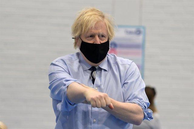 12 March 2021, United Kingdom, Enniskillen: UK Prime Minister Boris Johnson visits the Lakeland Forum vaccination centre in Enniskillen. Photo: Charles Mcquillan/PA Wire/dpa