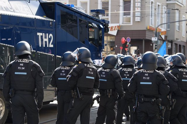 20 March 2021, Hessen, Kassel: Police forces stand guard during an unregistered demonstration against the government's Corona policy. Photo: Swen Pförtner/dpa