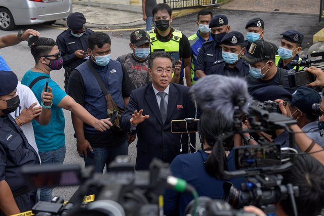 21 March 2021, Malaysia, Kuala Lumpur: Kim Yu Song, a counselor at the North Korean embassy to Malaysia, speaks the media outside the embassy after North Korea severed its diplomatic relations with Malaysia in response to Malaysia's extradition of a North