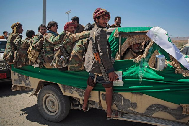 FILED - 09 March 2021, Yemen, Sanaa: Armed members of the Houthi rebel movement ride a vehicle during a funeral procession held for Houthi fighters who were allegedly killed in recent fighting with the Yemeni Saudi-backed government forces. Photo: Hani Al