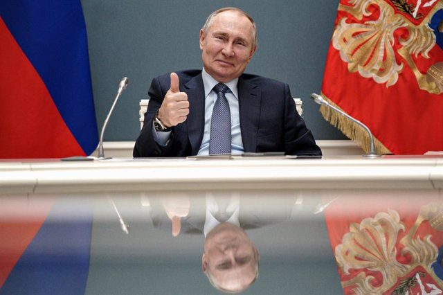 HANDOUT - 10 March 2021, Russia, Moscow: Russian President Vladimir Putin gestures during a via videoconference call with Turkish President Recep Tayyip Erdogan, during which they remotely inaugurate the construction of a third nuclear reactor of the Akku