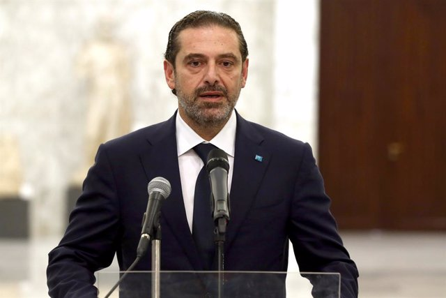 HANDOUT - 18 March 2021, Lebanon, Baabda: Lebanese Prime Minister-designate Saad Hariri speaks at a press conference following his meeting with President Michel Aoun at the presidential palace in Baabda. Aoun on Wednesday called on premier-designate Saad