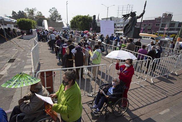 19 March 2021, Mexico, Nezahualcoyotl: Elderly people queue to receive the free CanSino coronavirus (Covid-19) vaccine in the municipality of Nezahualcoyotl. Photo: Antonio Nava/Prensa Internacional via ZUMA/dpa