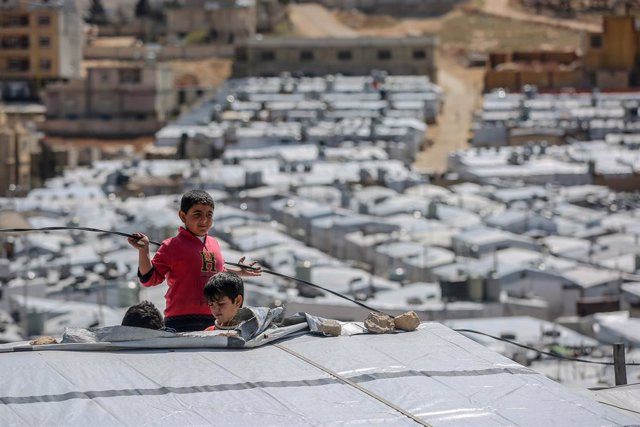 13 March 2021, Lebanon, Aarsal: Syrian refugee boys play at the Barra refugee camp in the Lebanese town of Aarsal, located north-east of capital Beirut. UNICEF said that after 10 years since the start of the Syrian conflict, war has left the lives and fut