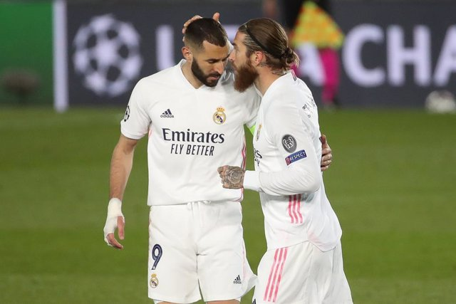 16 March 2021, Spain, Madrid: Real Madrid's Sergio Ramos and teammate Karim Benzema celebrate a goal during the UEFA Champions League round of 16 second leg soccer match between  Real Madrid and Atalanta BC at Estadio Alfredo Di Stefano. Photo: Indira/DAX