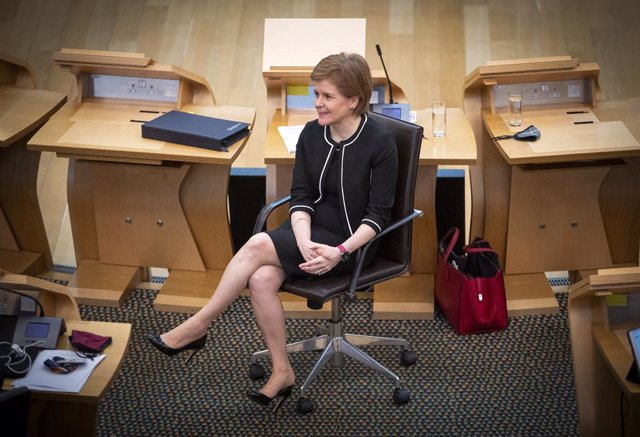 23 March 2021, United Kingdom, Edinburgh: Scottish First Minister Nicola Sturgeon sists at the main chamber ahead of a COVID-19 briefing at the Scottish Parliament in Holyrood. Photo: Jane Barlow/PA Wire/dpa