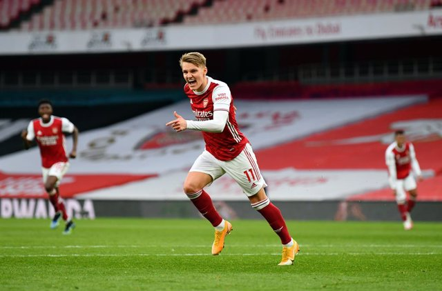 14 March 2021, United Kingdom, London: Arsenal's Martin Odegaard celebrates scoring hsi side's first goal during the English Premier League soccer match between Arsenal and Tottenham Hotspur at Emirates Stadium. Photo: Dan Mullan/PA Wire/dpa