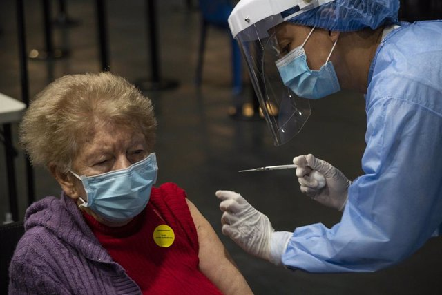 12 March 2021, Colombia, Bogota: A health worker injects and elderly woman with a dose of the Chinese Sinovac coronavirus vaccine during a vaccination campaign for elderly people in a vaccination centre Photo: Daniel Garzon Herazo/ZUMA Wire/dpa