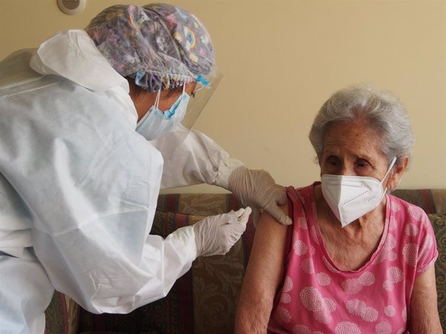 23 March 2021, Peru, Lima: An elderly woman receives her dose of a coronavirus vaccine as part of the Home Care Program for elderly. Photo: Carlos Garcia Granthon/ZUMA Wire/dpa