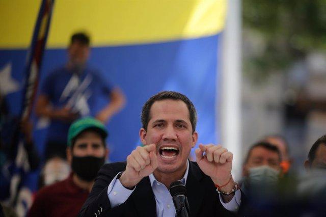 03 March 2021, Venezuela, Caracas: Venezuelan opposition leader Juan Guaido speaks during a press conference. Photo: Jesus Vargas/dpa