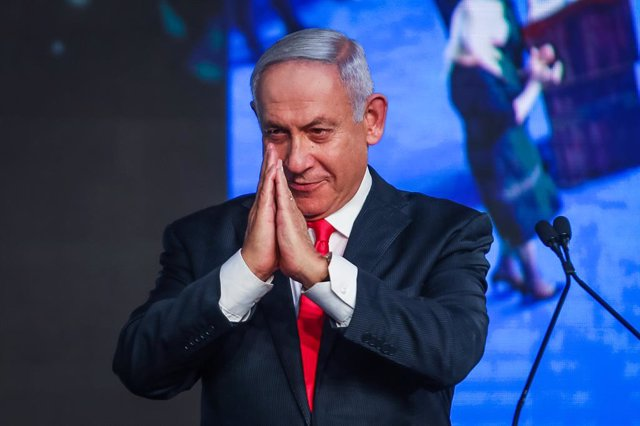 24 March 2021, Israel, Jerusalem: Israeli Prime Minister Benjamin Netanyahu addresses supporters on stage at the party headquarters after polls closed in the Israeli Parliamentary election. Photo: Noam Moskowitz/dpa