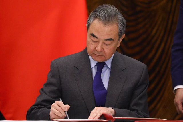 HANDOUT - 23 March 2021, China, Guilin: Chinese Foreign Minister Wang Yi signs a document during a signing ceremony with Russian Foreign Minister Sergey Lavrov (not pictured), after their meeting. Photo: -/Russian Foreign Ministry/dpa - ATTENTION: editori