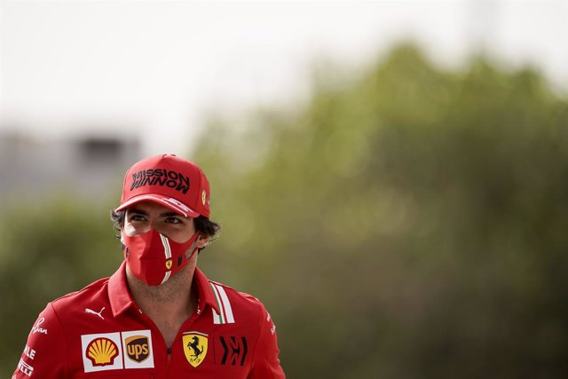 13 March 2021, Bahrain, Sakhir: Spanish Formula One driver Carlos Sainz Jr of team Scuderia Ferrari arrives at the track before the start of day two of the 2021 Formula 1 Pre-Season testing at the Bahrain International Circuit. Photo: James Gasperotti/ZUM