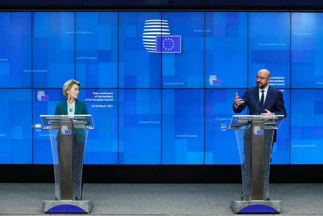 HANDOUT - 25 March 2021, Belgium, Brussels: European Council President Charles Michel (R) speaks during a press conferece with European Commission President Ursula von der Leyen after the online EU summit of heads of state and government at the European C