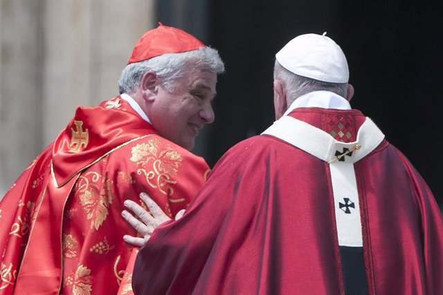 Archivo - June 9, 2019 - Vatican: Pope Francis speaks with Card. Konrad Krajewski during the Pentecost Mass in Saint Peter's square at the Vatican. (Alessia Giuliani/CPP/Contacto)