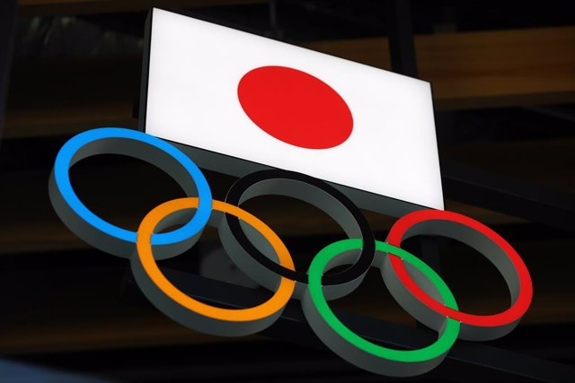 15 March 2021, Japan, Tokyo: Japanese flag with Olympic Rings are seen above the entrance to Japan Olympic Museum in Shinjuku. Photo: Stanislav Kogiku/SOPA Images via ZUMA Wire/dpa