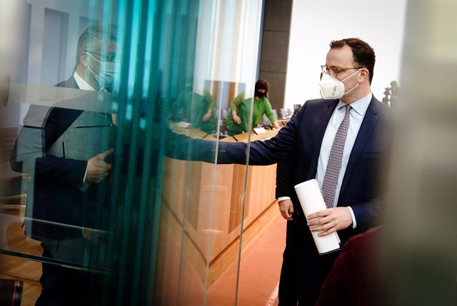 26 March 2021, Berlin: German Minister of Health Jens Spahn (R) and President of the Robert Koch Institute Lothar Wieler leave after attending a press conference on the Corona situation before Easter. Photo: Kay Nietfeld/dpa