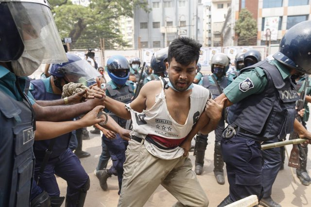 27 March 2021, Bangladesh, Dhaka: Bangladeshi police arrest a protester in front of the National Press Club during a protest against the visit of Indian Prime Minister Modi. Photo: Suvra Kanti Das/ZUMA Wire/dpa