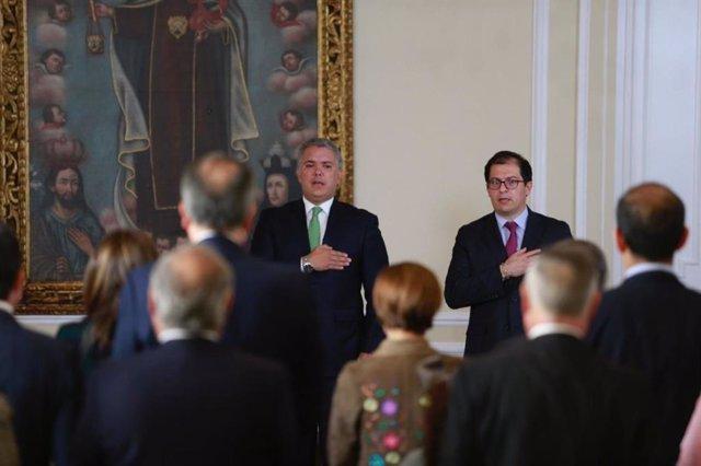Archivo - El presidente de Colombia, Iván Duque, y el nuevo fiscal general, Francisco Barbosa.