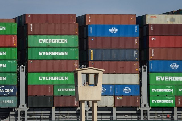 """29 March 2021, Egypt, Suez: The """"Ever Given"""" container ship operated by the Evergreen Marine Corporation, sails on the Suez Canal, after it was fully freed and floated. Egypt's Suez Canal Authority announced that the stranded massive container ship that h"""