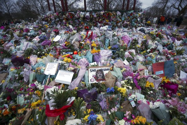 14 March 2021, United Kingdom, London: Floral tributes are left at the Bandstand on Clapham Common, a day after clashes between police and crowds who gathered at the site to remember Sarah Everard. The Metropolitan Police has faced intense criticism for i