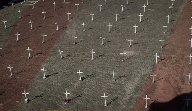 29 March 2021, Brazil, Farroupilha: Crosses can be seen in front of the Nossa Senhora de Caravaggio church during a memorial service for more than 300000 COVID-19 deaths in Brazil. Photo: Lucas Amorelli/dpa