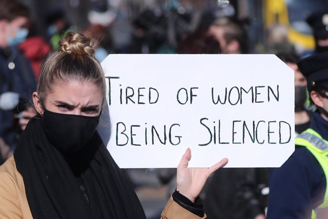 16 March 2021, Ireland, Dublin: A protester holds a sign during a protest organised in remembrance of murdered Sarah Everard and in protest of continued violence against women. Photo: Niall Carson/PA Wire/dpa