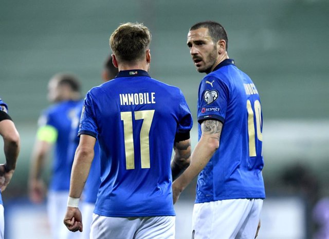 25 March 2021, Italy, Parma: Italy's Ciro Immobile (L) celebrates scoring his side's second goal with teammate Leonardo Bonucci during the 2022 FIFA World Cup European Qualifiers group C soccer match between Italy and Northern Ireland at Stadio Ennio Tard