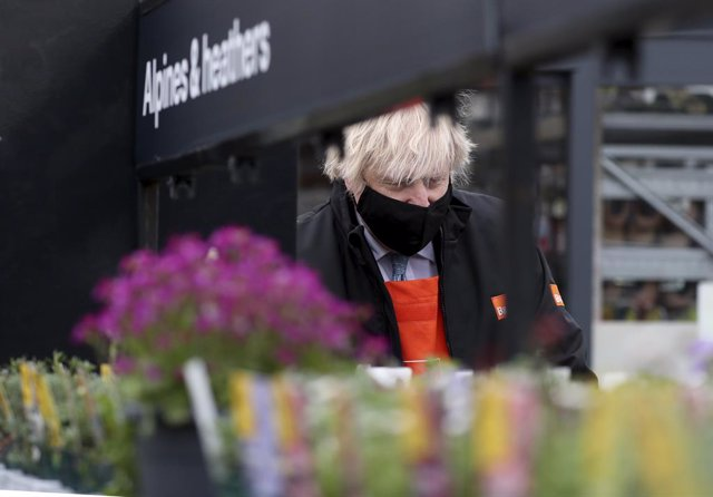01 April 2021, United Kingdom, Teesside: British Prime Minister Boris Johnson visits the garden centre of the B&Q store in Middlesbrough. Around two million of the UK's lowest-paid workers will receive a pay rise from Thursday with increases in statutory