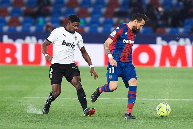 Jose Luis Morales of Levante UD and Thierry Correia of Valencia CF  during the La Liga Santander match between Levante and Valencia at Estadio Ciutat de Valencia on 12 March, 2021 in Valencia, Spain