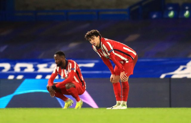 17 March 2021, United Kingdom, London: Atletico Madrid's Sequeira Joao Felix (R) and Thomas Lemar appear dejected after the UEFA Champions League round of 16 second leg match between Chelsea and Atletico Madrid at Stamford Bridge. Photo: Adam Davy/PA Wire