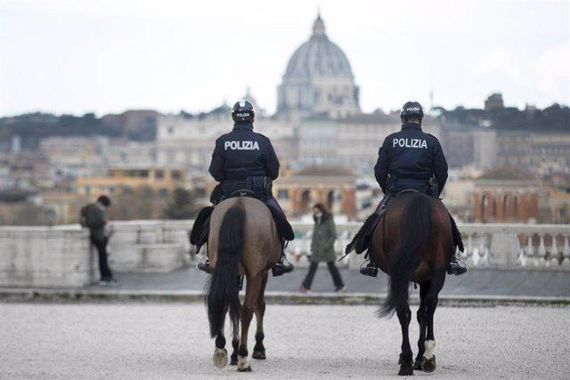 16 March 2021, Italy, Rome: Two policemen of the equestrian squad ride through the park of the Villa Borghese. Photo: Roberto Monaldo/LaPresse via ZUMA Press/dpa