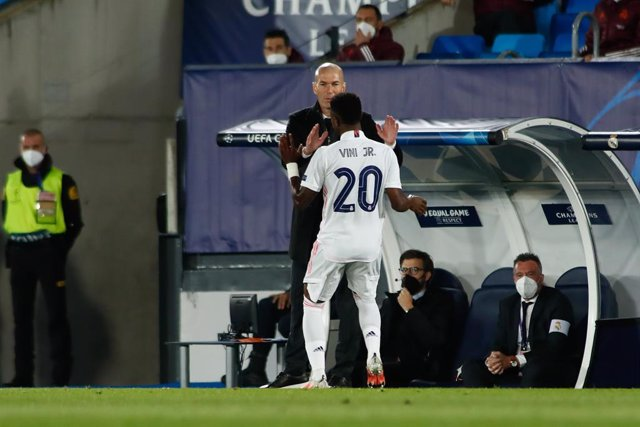 Vinicius Junior of Real Madrid celebrates a goal with Zinedine Zidane, head coach of Real Madrid, during the UEFA Champions League, Quarter finals round 1, football match played between Real Madrid and Liverpool FC at Alfredo Di Stefano stadium on April 0