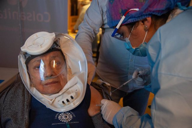 09 March 2021, Colombia, Bogota: An elderly women receives her dose of the Chinese COVID-19 Vaccine Sinovac at a vaccination centre. Photo: Chepa Beltran/VW Pics via ZUMA Wire/dpa