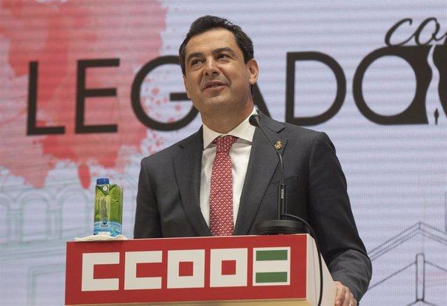 El presidente de la Junta de Andalucía, Juanma Moreno, durante su intervención en el acto de inauguración de la nueva sede de CCOO en Sevilla